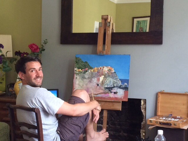 This is me painting a picture of the fishing village called Manarola in Italy.